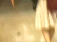 Upskirt panties voyeur video of a shy brunette