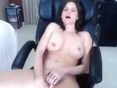 Brunette Daisy fucks pussy on the couch