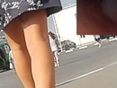 Upskirting cute slim girl in the wonderful sunny day