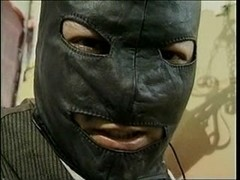 Bondage act with a tranny and chap in mask
