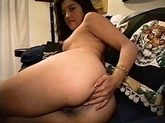 Curvy lalin girl hottie plays with spiky fake penis on daybed