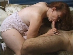 Redhead granny receives busy
