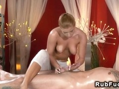 Blonde masseuse giving massage on big dick