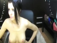 The black-haired beauty 01Amiana playing with her shaved pussy