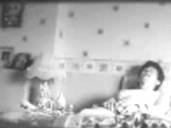 My mum masturbating on bed caught by my hidden cam
