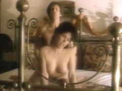 Horny naked brunette sucks and gets fucked doggystyle in bed in retro movie