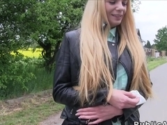 Leaning on cars hood blonde bangs outdoor in public