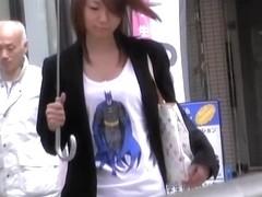 Asian babe in a short skirt gets a street sharking.