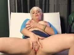 Milf with big tits is rubbing her beaver