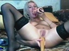 Blonde Whore Rams a Stick in Her Ass