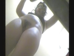 Girl is demonstrating her well trimmed cunt on voyeur movie