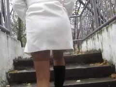 Girl flashing tan stockings going upstair