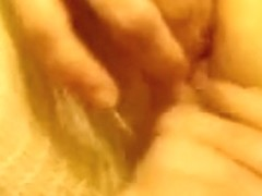 My bbw amateur wifey likes being filmed while masturbating. She is touching her clit and fingering.