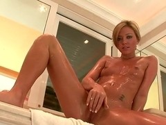 Natalia Forrest taking a shower and masturbating her wet pussy