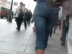 Golden haired beauty with bangs walks the streets candid porn