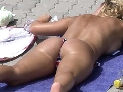 Hot babe laying out in Thong