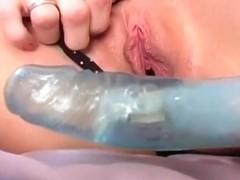 Sticking a big dildo up my bald twat