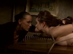 Rude bitch Issa Bella tied up her young girlfriend Mandy Bright to the table and rudely scoffing on helpless chick.