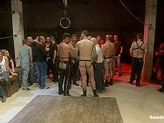 Bound in Public. Southern stud gets fucked and showered with cum in front of 100 men