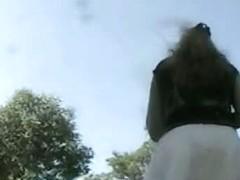 A Brunette and a black hair woman get filmed by a spy cam upskirt