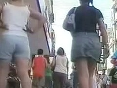 Summer girl with pony tails and jeans skirt voyeur video