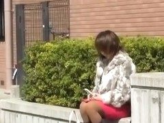 Sharking video with a lovely Japanese girl sitting outdoors