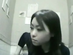 Nice asian woman is caught on camera while pissing in toilet