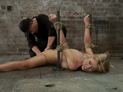 Flexible Blond MILF is tied in the splits. We cane, flog & make this mom cum like a whore.