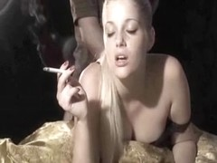 Amazing blonde smoking while being fucked from behind
