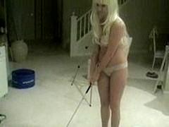 Maid on knees sucking rod