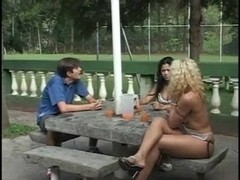 Teens have a threeway sex outdoors
