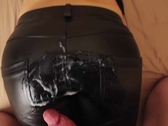 Cumshot on girlfriend's hot leather pants covered ass