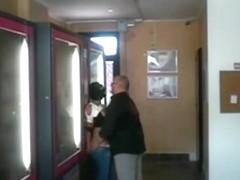 Strange dude lets a girl suck him off in a public place like a burglar
