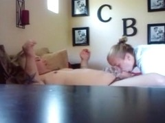 Chubby wife gives her fat husband a blowjob on the bed