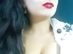 The smoking brunette busty princess on webcam puffing again
