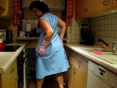 Mature German Lady trying on aprons
