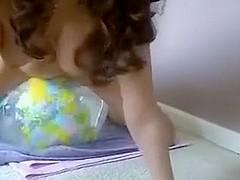 naked girl riding transparent earth beachball
