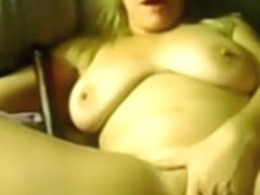 Amateur big tit milf fingers her twat while on webcam