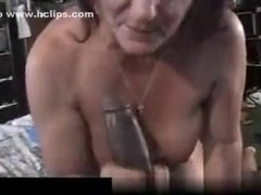 Ugly milf moans like crazy, as her black stud fucks her pussy.