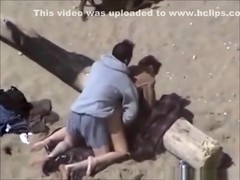 Voyeur tapes a horny couple fucking at the beach