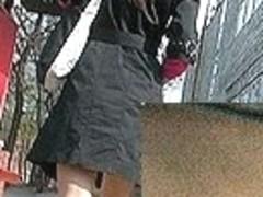 Nylon tights up darksome lady's coat