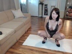Dark Haired Camgirl Plays With Big Dildos