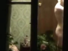 Voyeur window peeping video of neighbor
