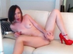 Cutie with red heels masturbates on the sofa