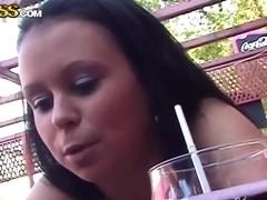 Naughty brunette honey having oral funs in the park