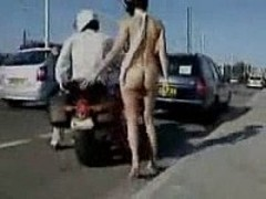Naked on a motorcycle