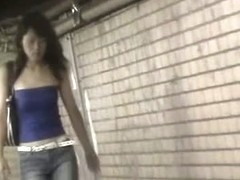 Public sharking video features a cute Asian girl getting her tits exposed.