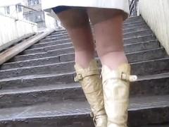 Baby flashing tan stockings tops going upstairs