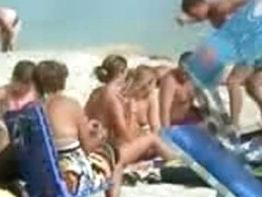 Nice young tits - beach voyeur video