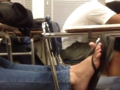 Candid feet flip flops on chair